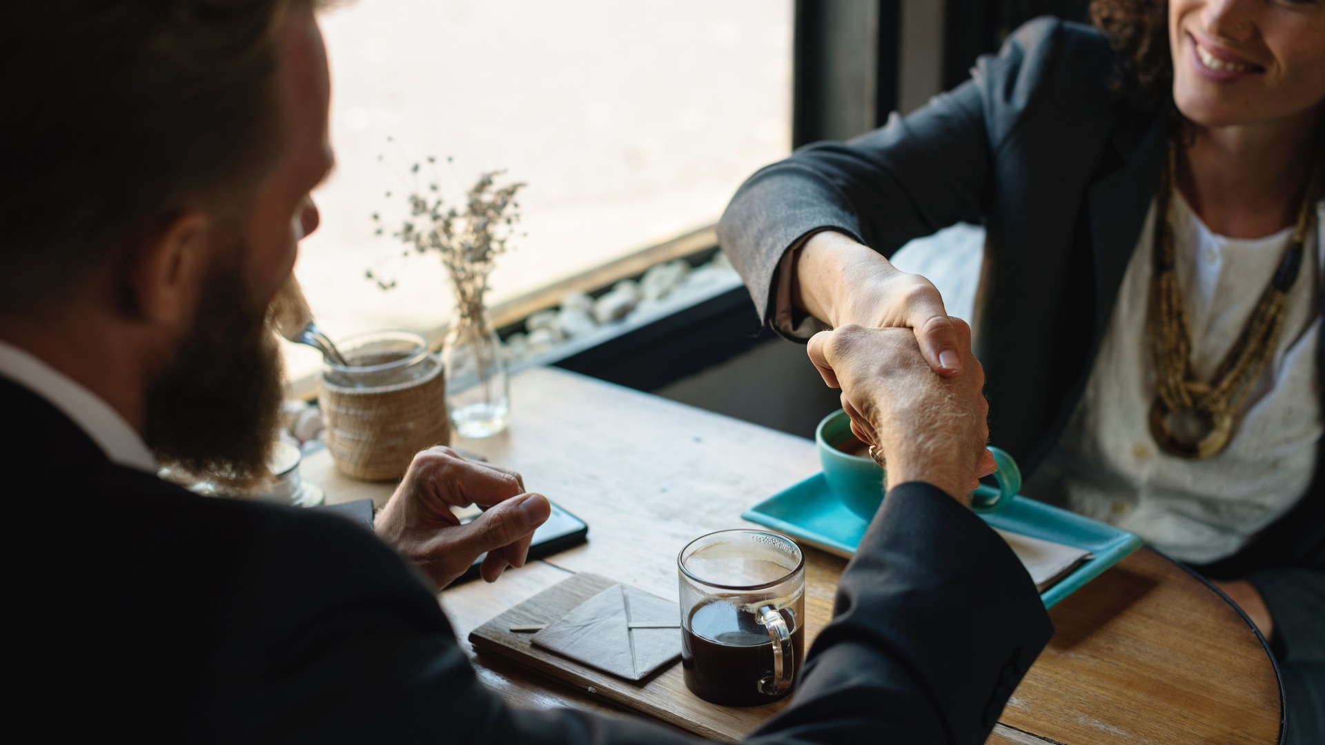 Two professionals shaking hands at a job interview