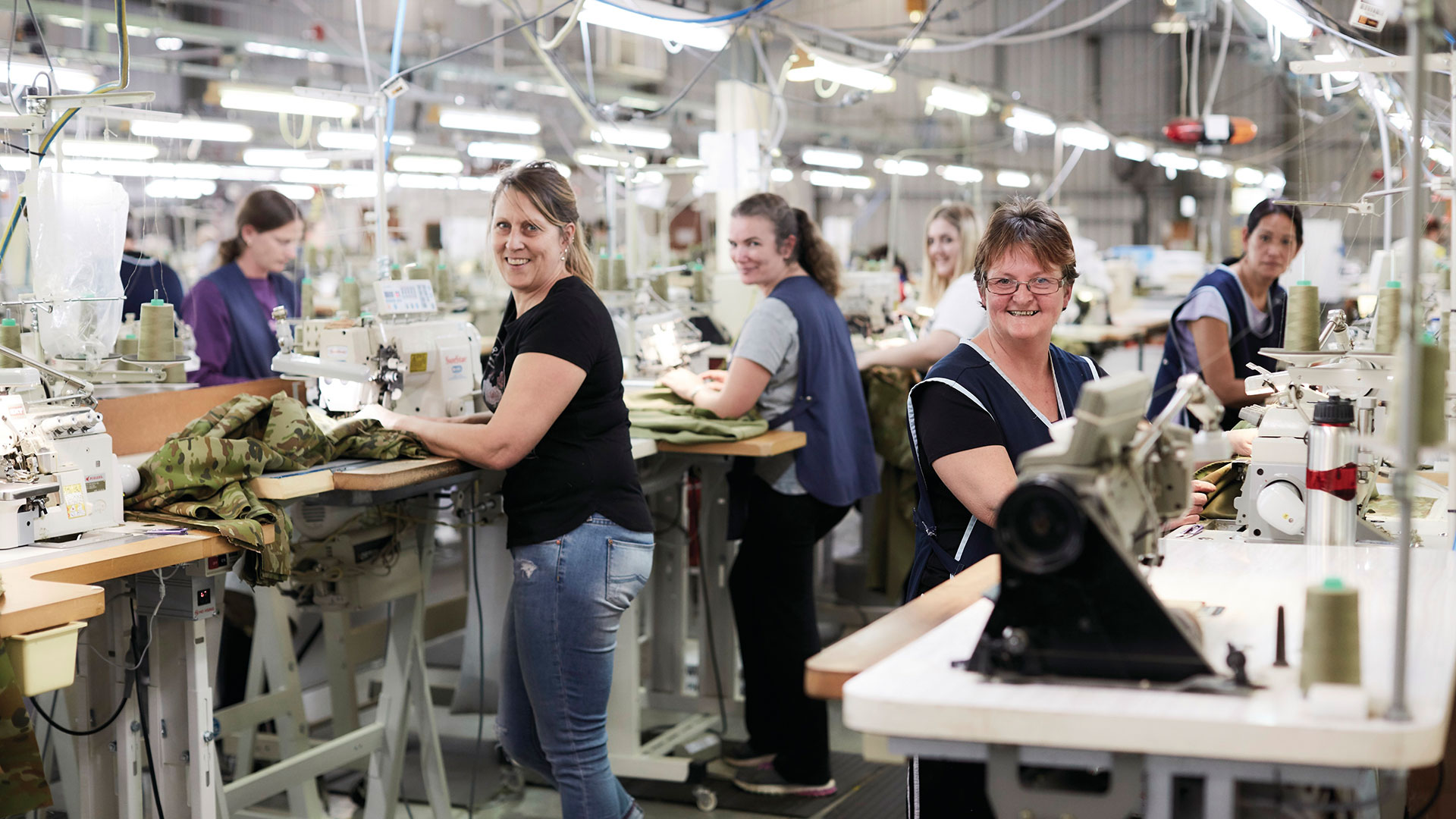 A group of women manufacturing uniforms for the Australian Defence Force.