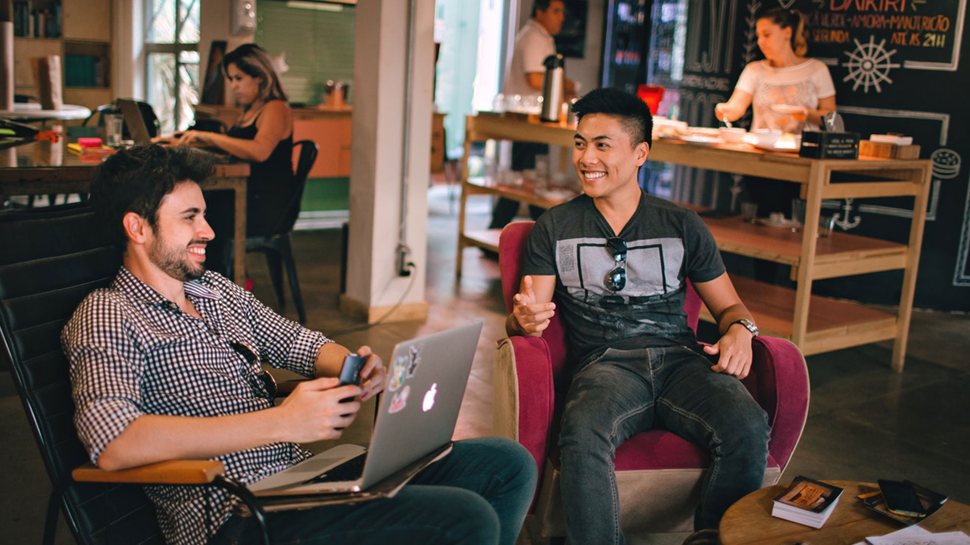 Two men in their 20s network at a coffee shop